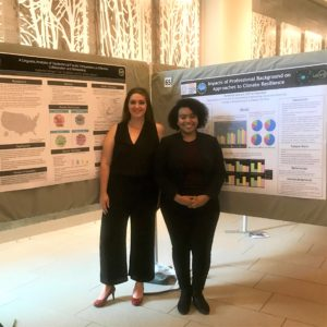 Two WiSE summer research scholars stand next to their posters